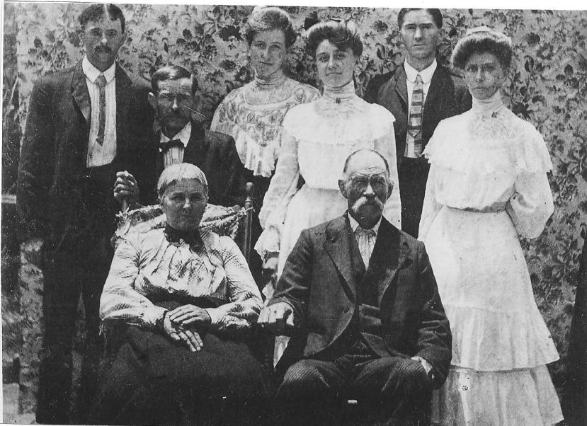 Front row: Sophronia Tisdale Bynum and William A. Bynum. back row: Aden G. , Wm. Washington, Annie, Bessie, Leon S., and Ina Bynum.