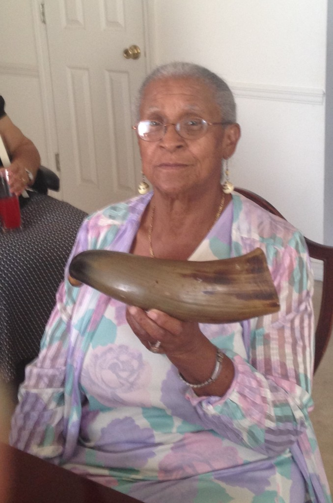 Emma Strong, displaying the horn her family's tradition holds was owned by Newt Knight during the Civil War. Soso, MS, 9-15-16.
